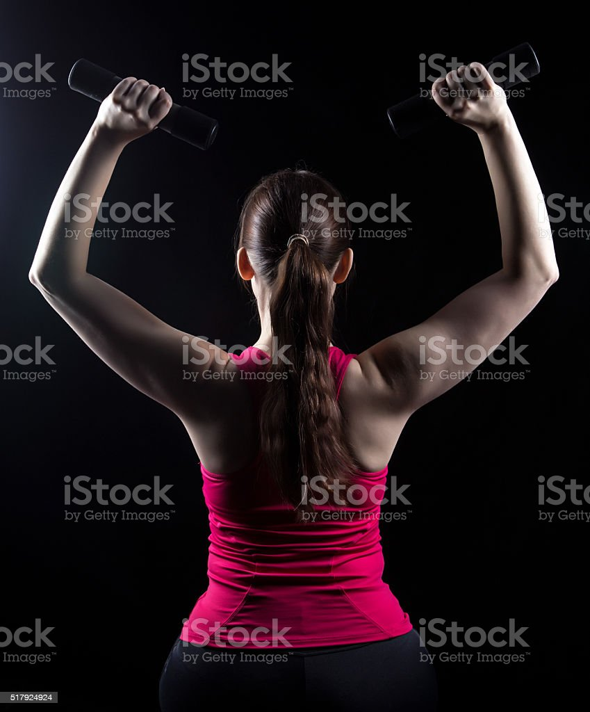 Fitness trainer with weights in the hands stock photo