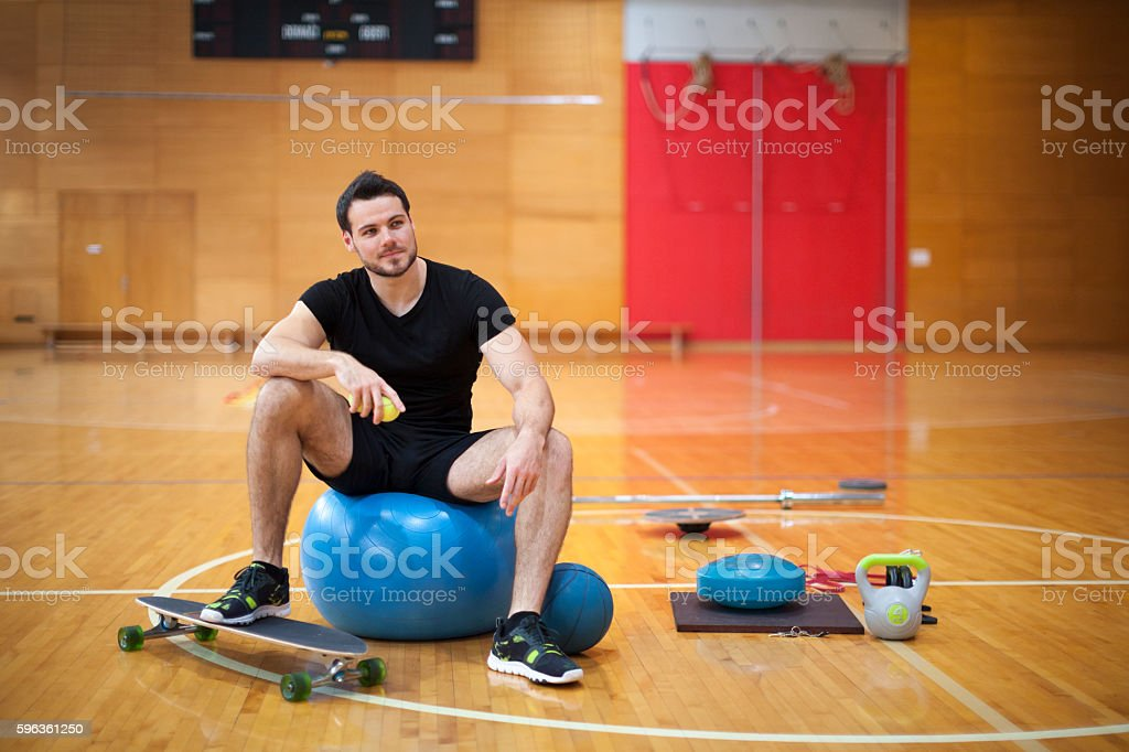 Fitness Trainer with Workout Equipment in Gym royalty-free stock photo