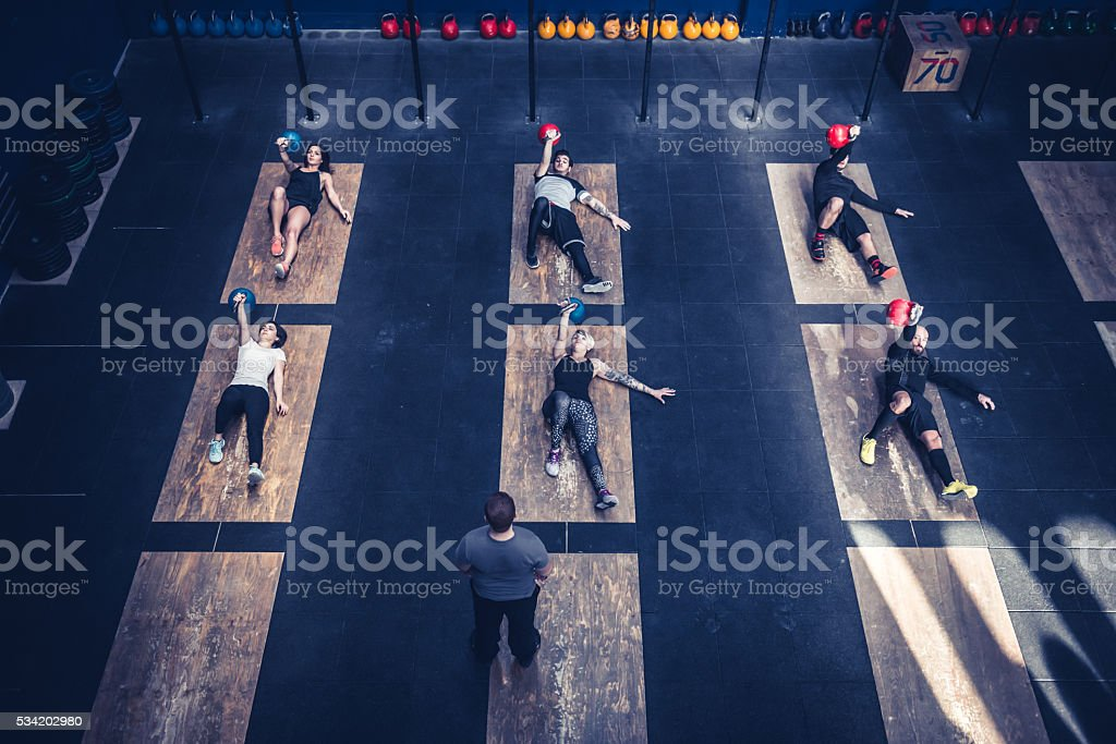 Fitness training class lifts weights stock photo