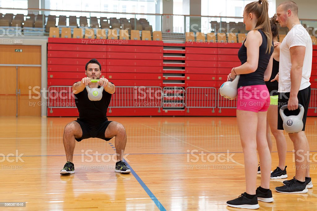 Fitness Training of a Group of Young Athletes in Gym royalty-free stock photo