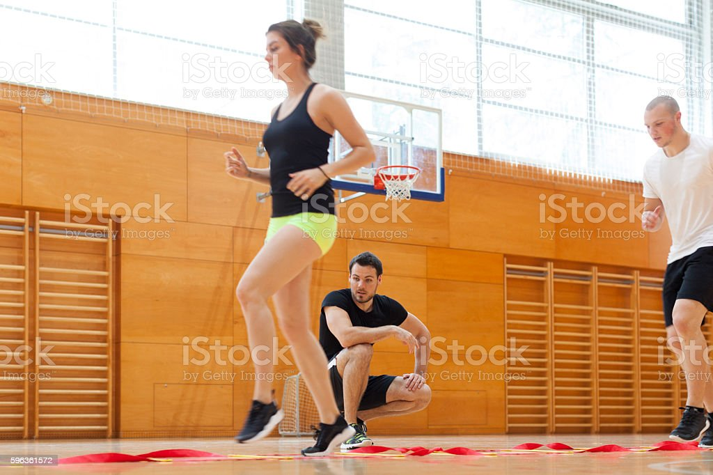 Fitness Training of a Group of Young Athletes With Instructor royalty-free stock photo