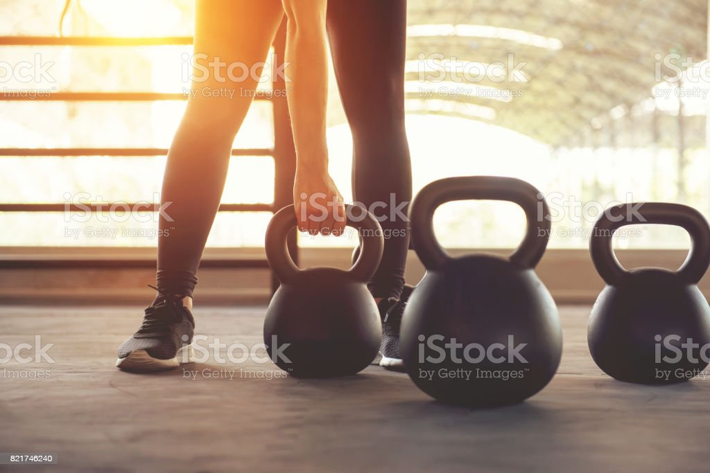 Fitness training with kettlebell in sport gym. stock photo