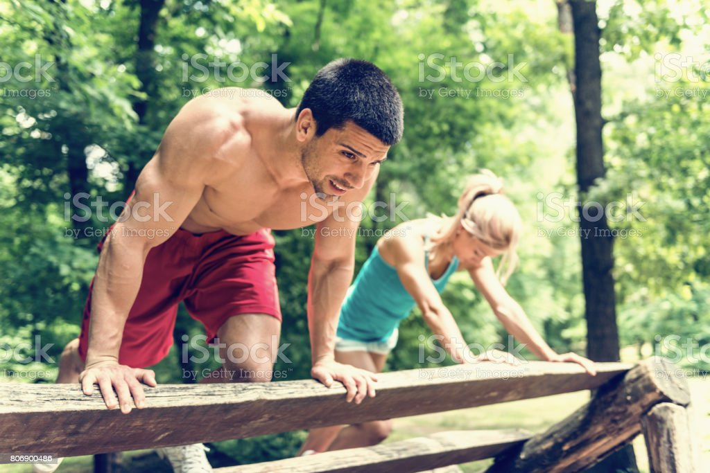 Fitness trial exercising couple stock photo
