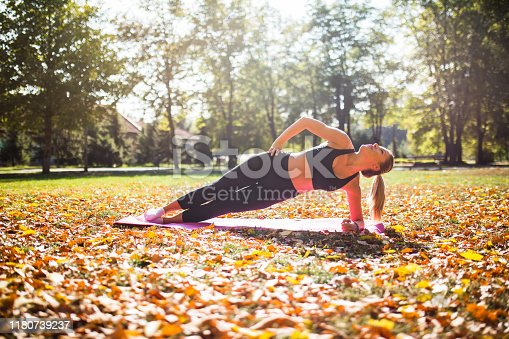 Fitness woman at stretching training outdoors