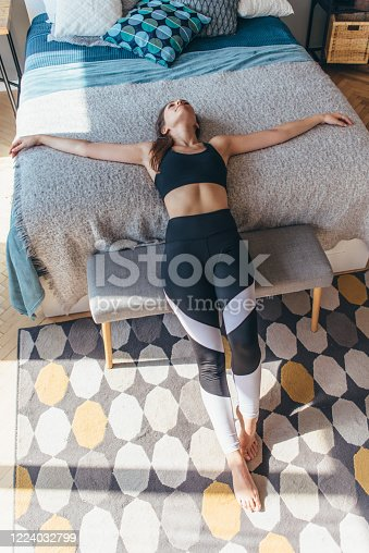 Fitness woman athlete lying on the bed and resting