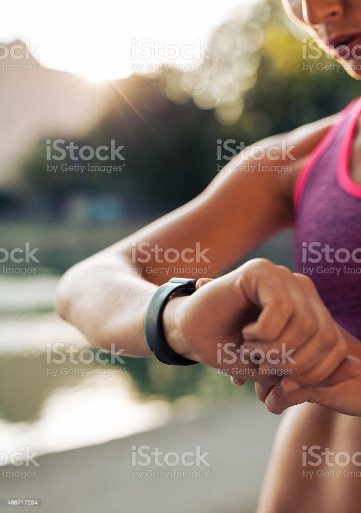 Fitness woman checking her performance on smartwatch stock photo
