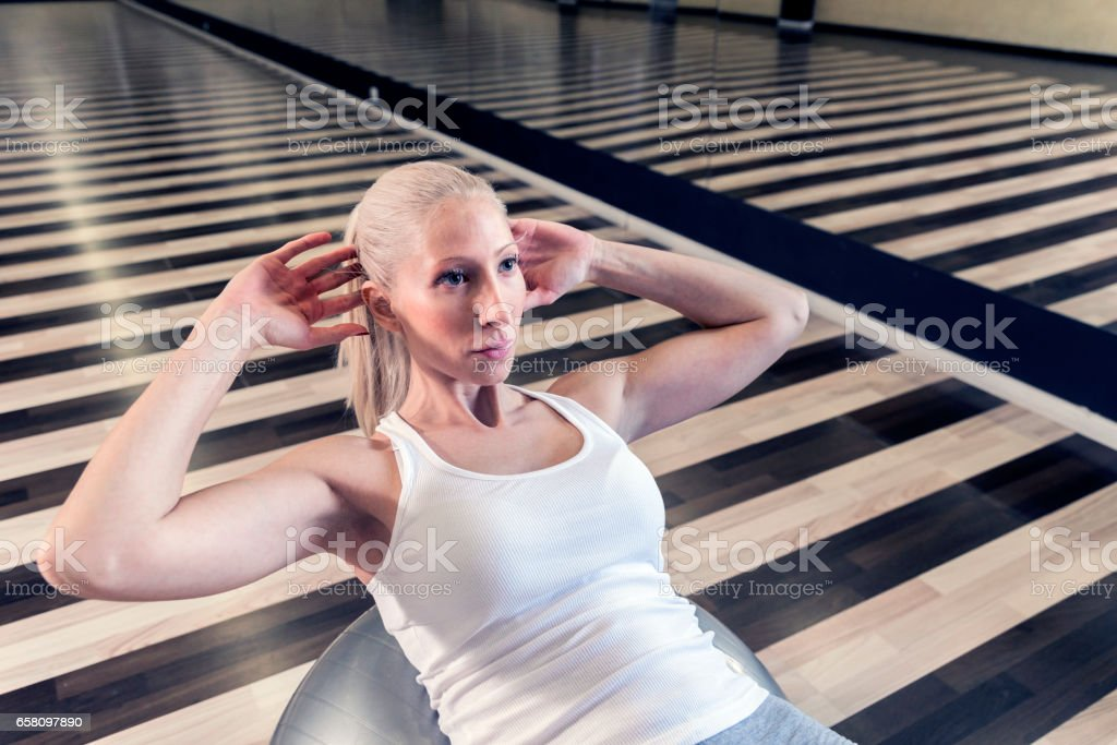 Fitness woman doing abs workout at the gym royalty-free stock photo