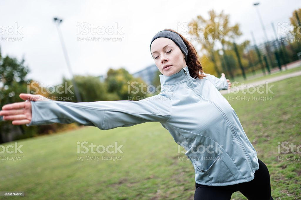 fitness woman doing exercise on the park stock photo