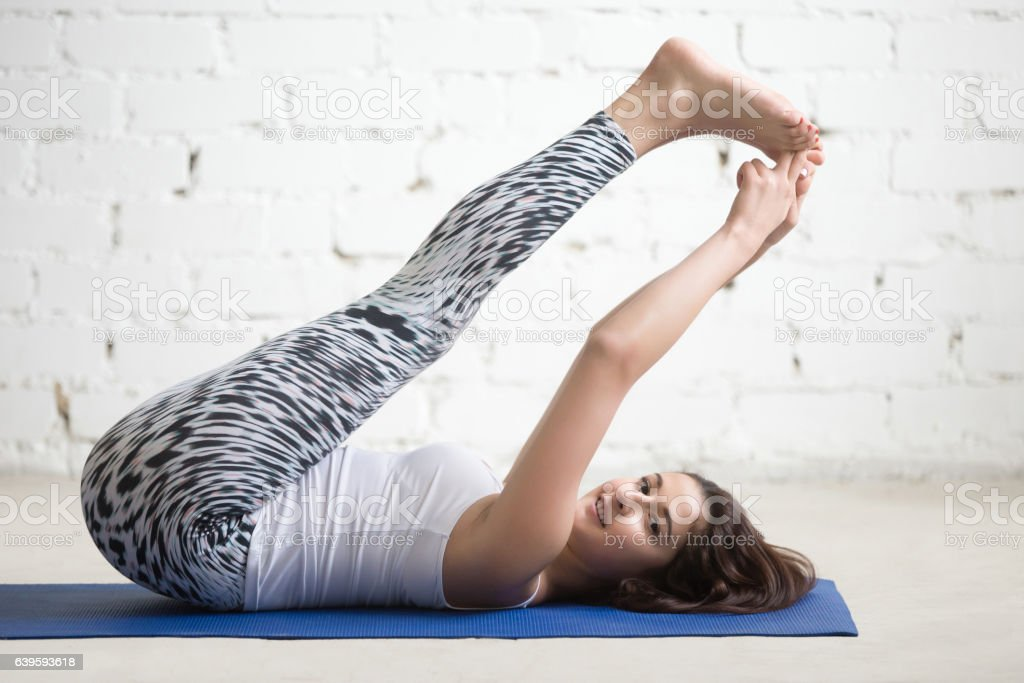 Fitness woman doing exercises on sport mat stock photo