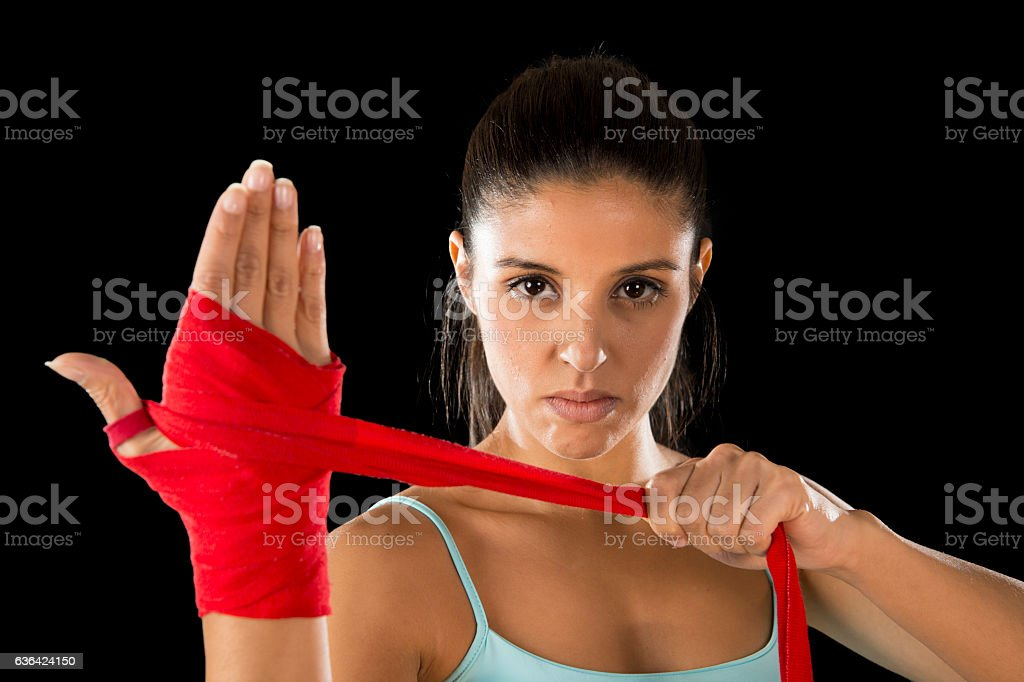 fitness woman doing hand wraps before boxing or fighting workout stock photo