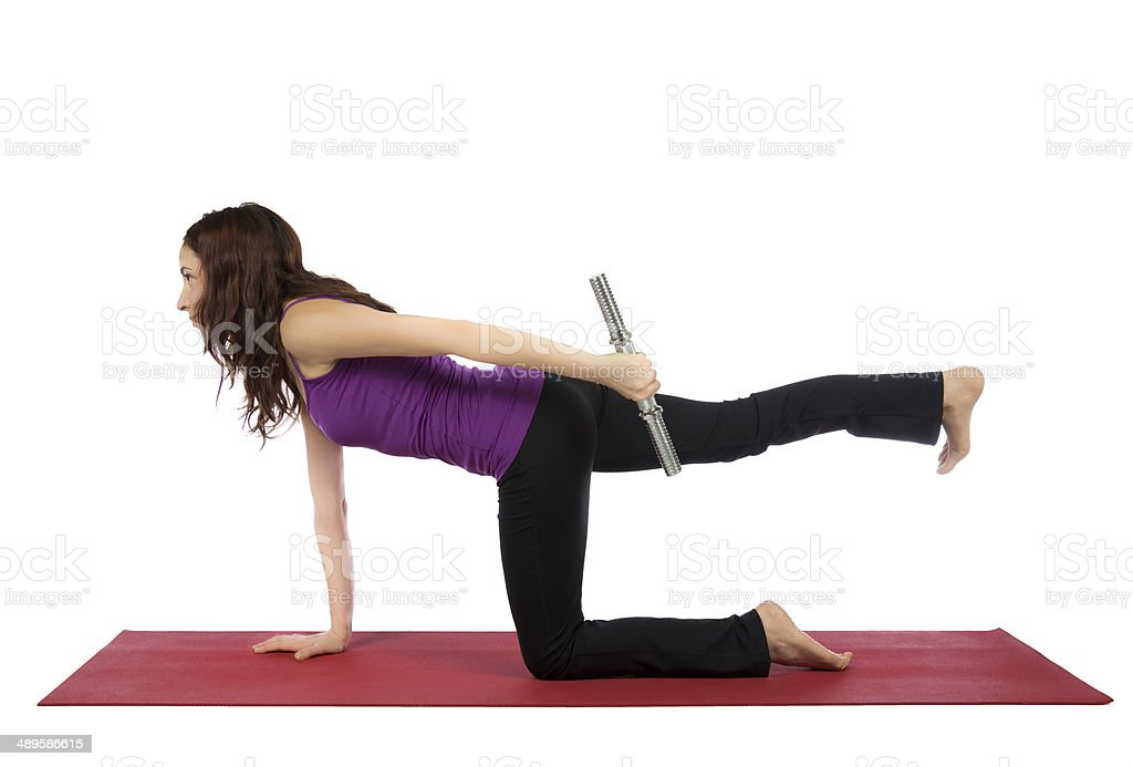 Fitness woman doing kneeling triceps kickback stock photo