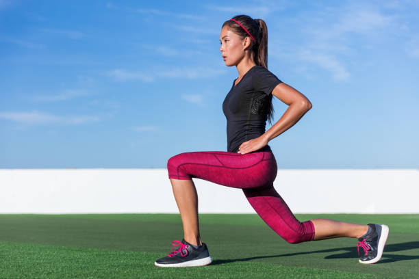 Fitness woman doing lunges leg workout exercises Fitness woman doing lunges exercises for glute and leg muscle workout training core muscles, balance, cardio and stability. Active gym girl doing front forward one leg step lunge exercise. hamstring stock pictures, royalty-free photos & images