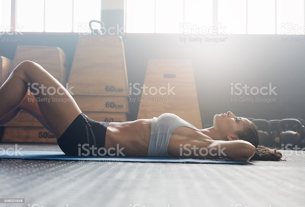 Fitness woman doing sit ups at gym - Photo