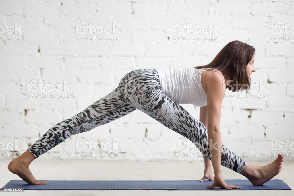 Fitness woman doing splits on sport mat stock photo