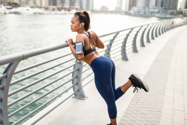 fitness woman doing stretching in dubai marina - Photo