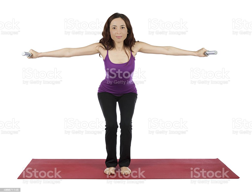 Fitness woman doing triceps kickback during workout stock photo