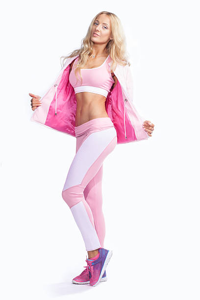 fitness woman dressed in pink sportswear isolated stock photo