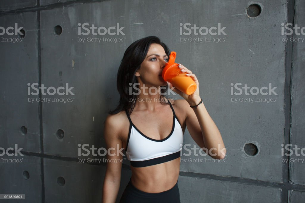 fitness woman drink cocktail stock photo