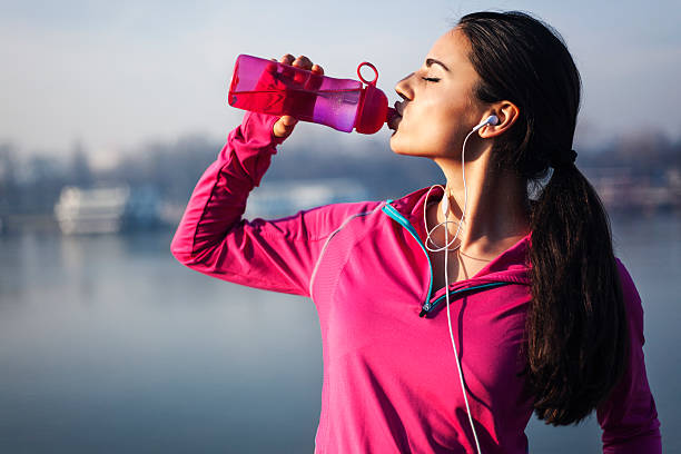 fitness woman drinking water - drinking water stock photos and pictures