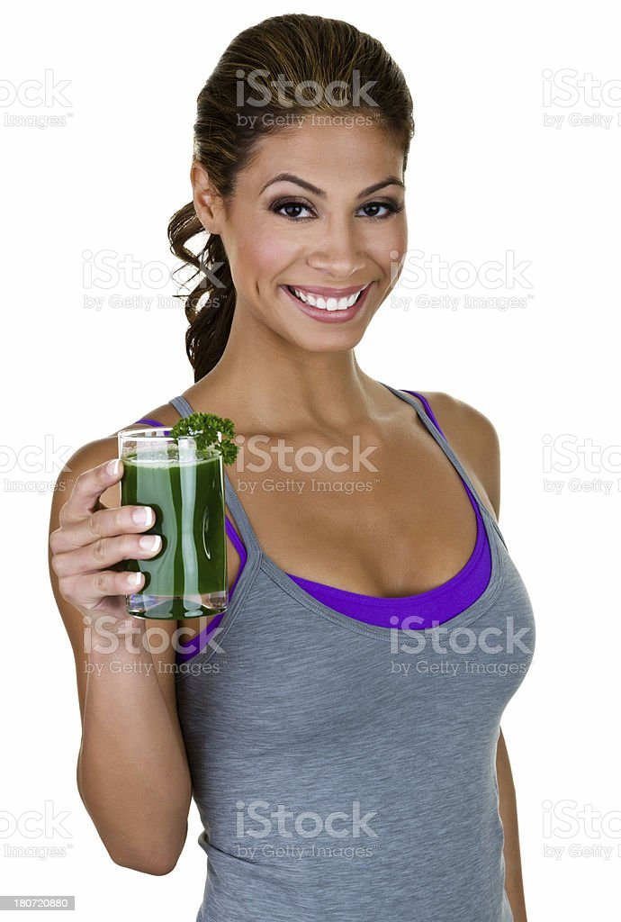 Fitness woman holding green juice royalty-free stock photo