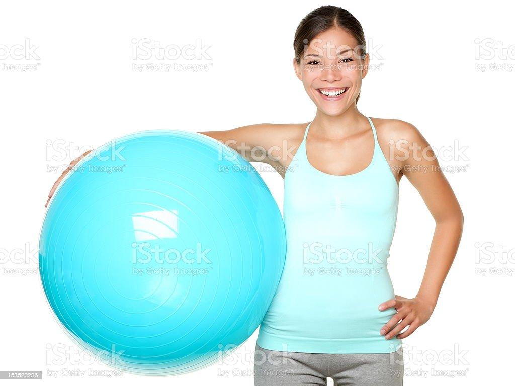 Fitness woman holding pilates ball stock photo
