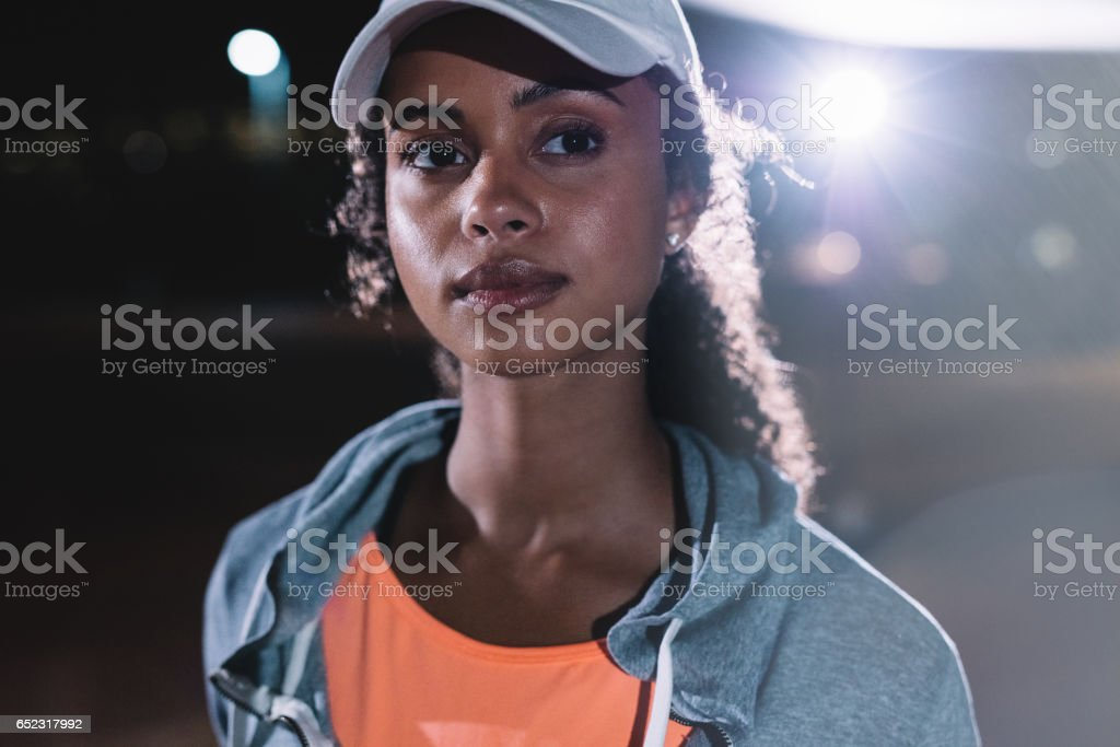 Fitness woman in city at night stock photo