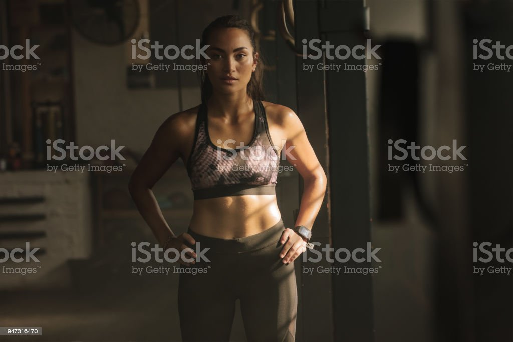 Fitness woman in the cross training gym stock photo