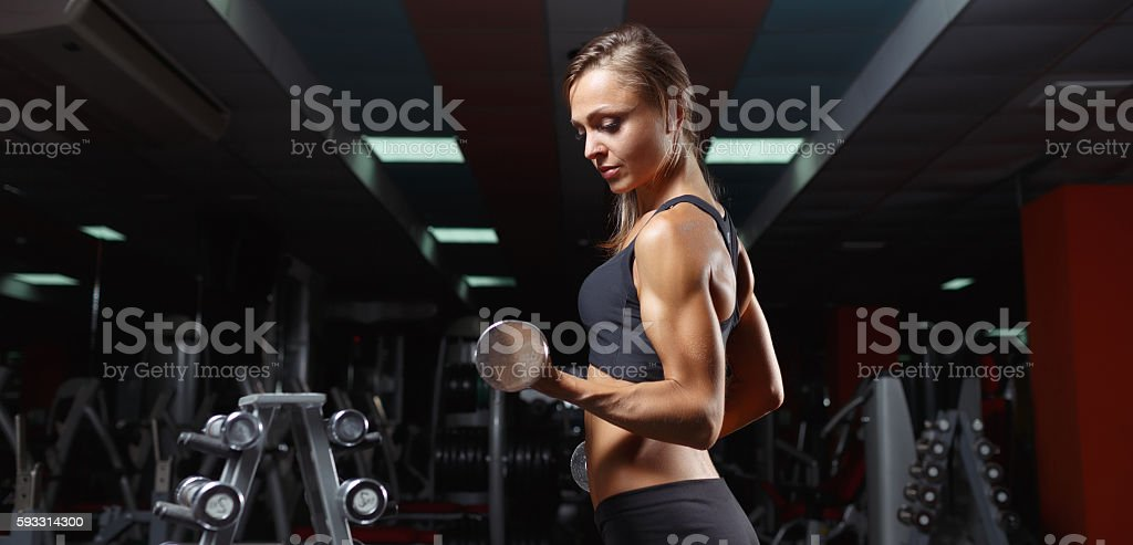 Fitness woman in the gym stock photo