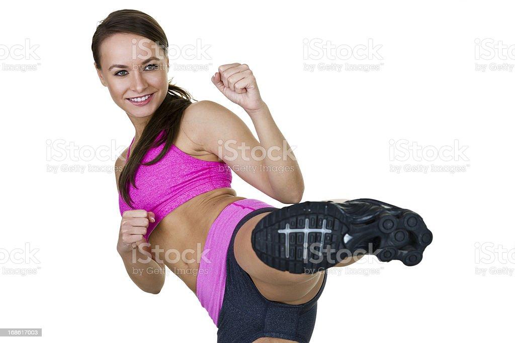 Fitness woman kicking stock photo