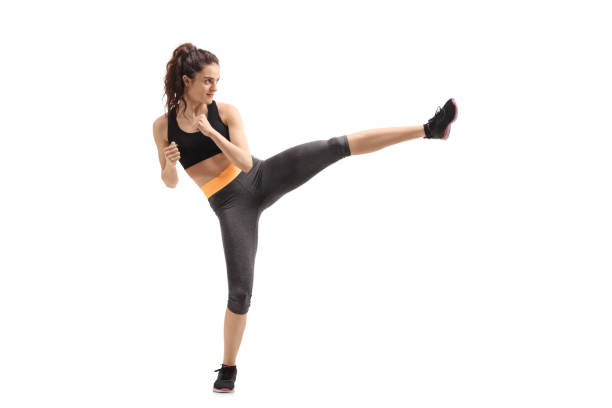 Fitness woman kicking stock photo