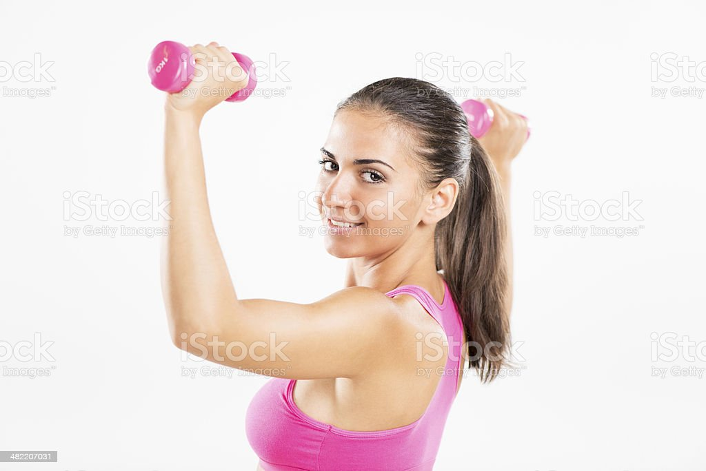 Fitness woman lifting dumbbells royalty-free stock photo