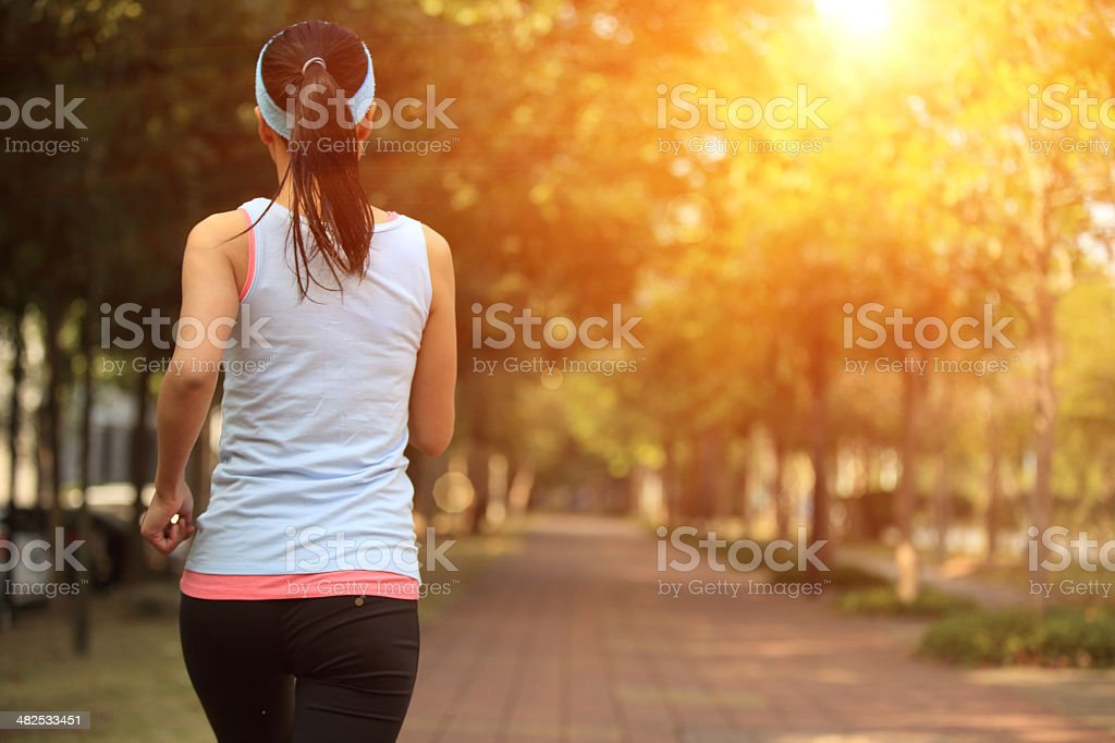 fitness woman morning exercise jogging at park stock photo