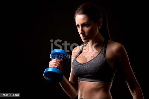 istock fitness woman on black background 503110050