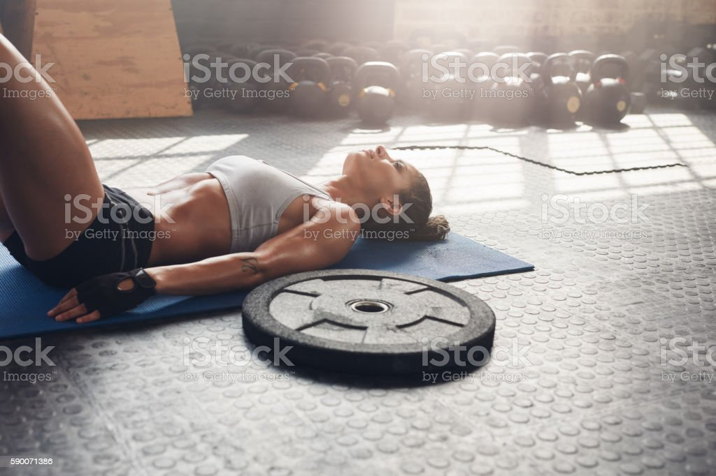 Fitness woman relaxing after heavy weight workout stock photo