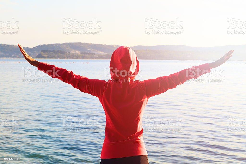 Fitness woman relaxing after running outdoors near sea. Lizenzfreies stock-foto