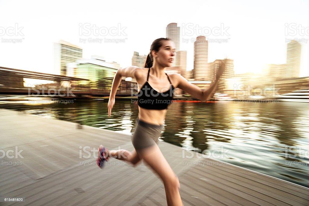Fitness Woman running against the boston skyline stock photo