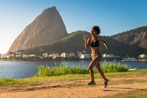 Fitness Woman Running on a Dirt Road stock photo