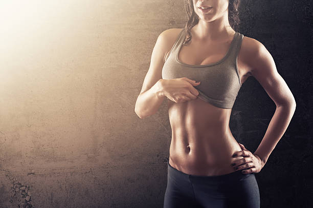 Fitness woman showing her fit body stock photo