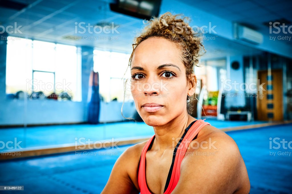 Fitness woman sitting in gym stock photo