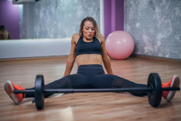 Fitness woman sitting on the floor stock photo