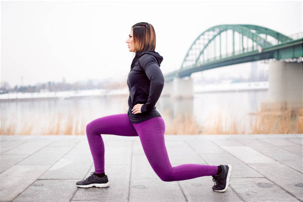 fitness woman split squat exercise outdoor - lunge stock photos and pictures