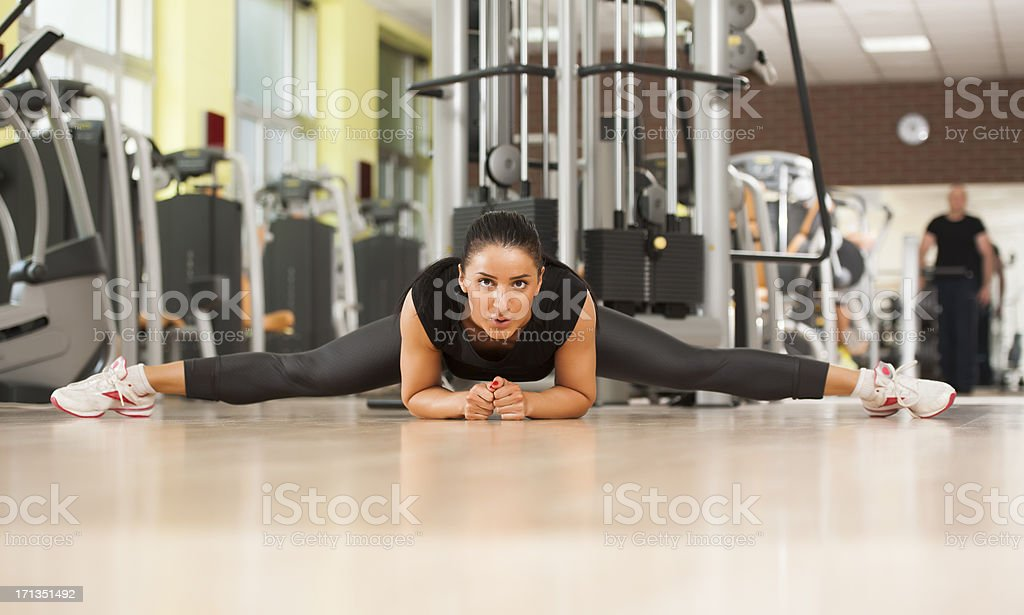 Fitness Woman stretching on the floor royalty-free stock photo