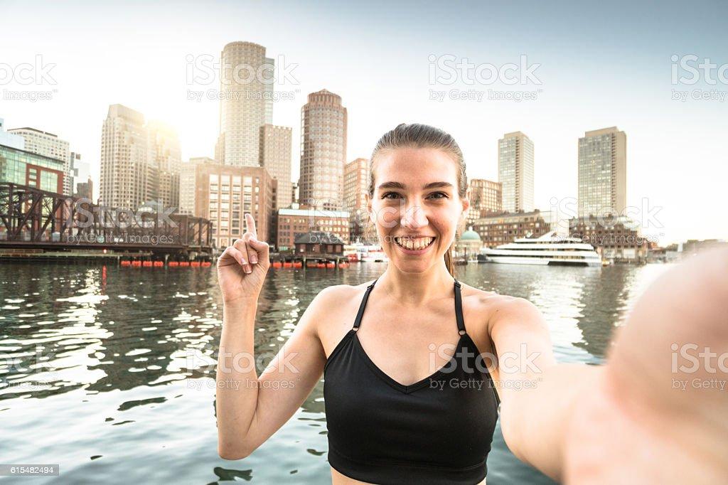 Fitness Woman take a selfie in Boston stock photo