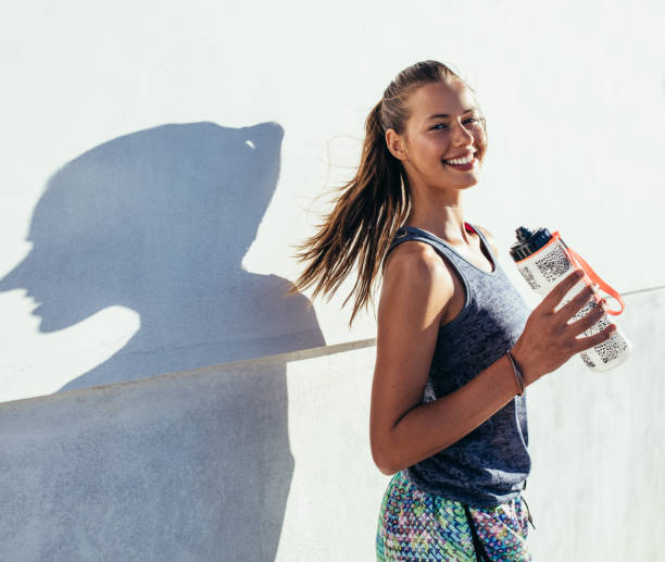 Fitness woman taking a break after running workout picture id646186056?b=1&k=6&m=646186056&s=612x612&w=0&h=56tecziwvbemunsglezzteezdhecvgaqdyapapigwyy=
