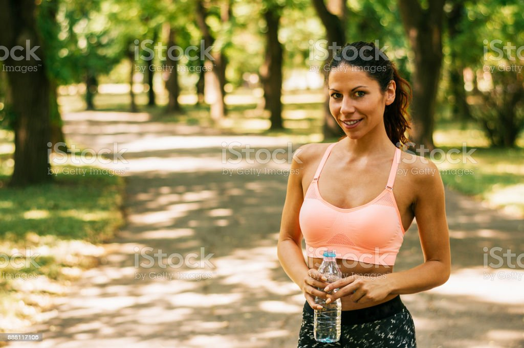 Fitness woman taking a break after running workout. stock photo