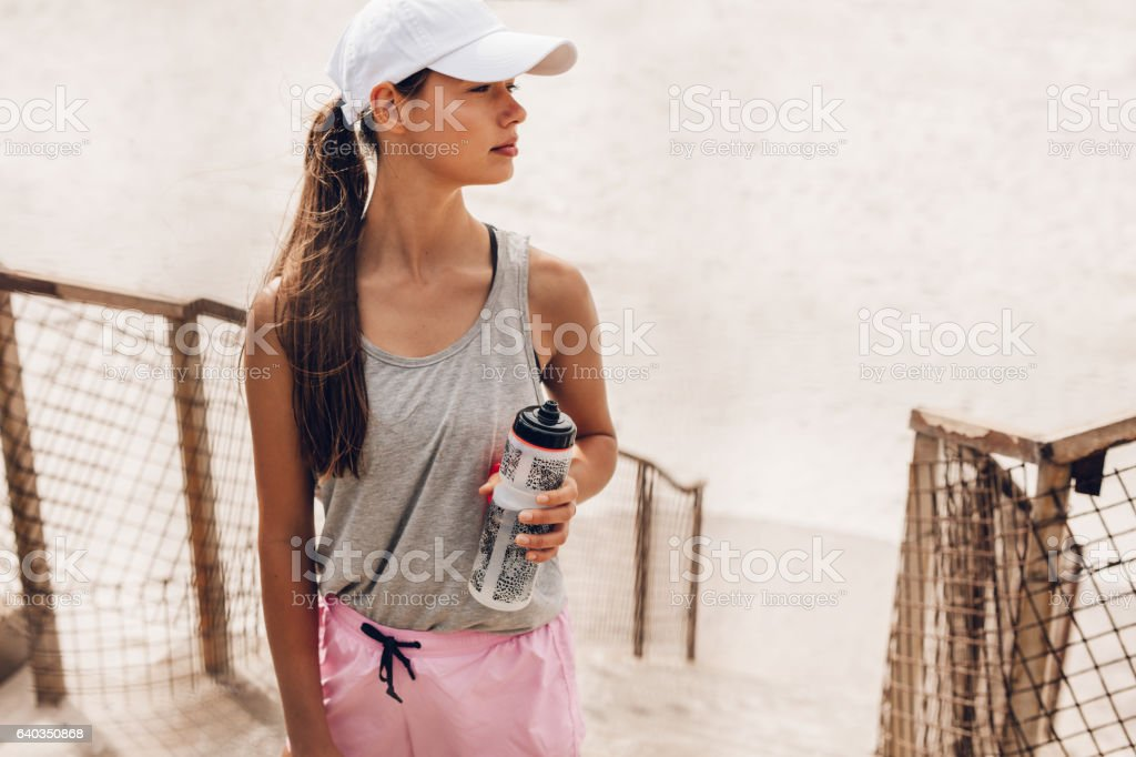 Fitness woman taking a break after workout stock photo