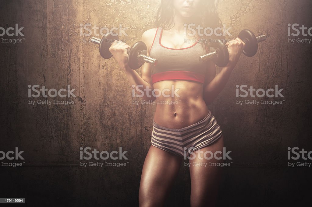 Fitness woman training with dumbbellss stock photo