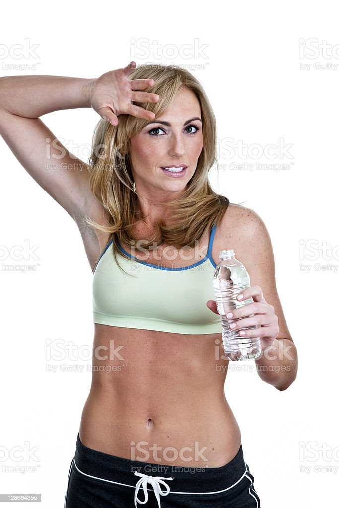 Fitness woman wiping sweat holding water bottle royalty-free stock photo