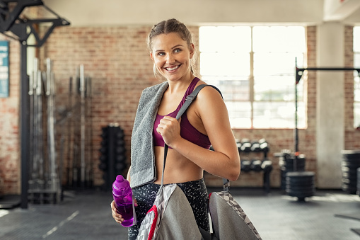 istock Fitness woman with bag at gym 1149242907