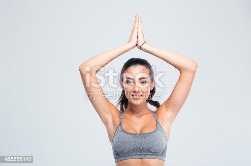 istock Fitness woman with joined hands over head 485558142